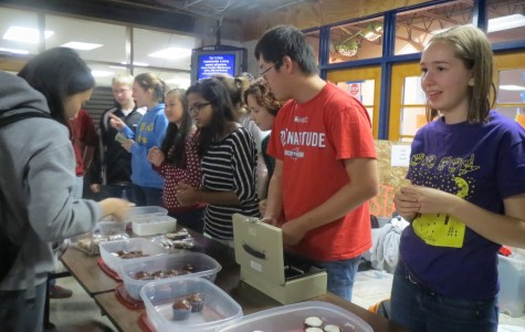 Meyers works to raise money for the American Sign Language Club at a bake sale held before eighth period.