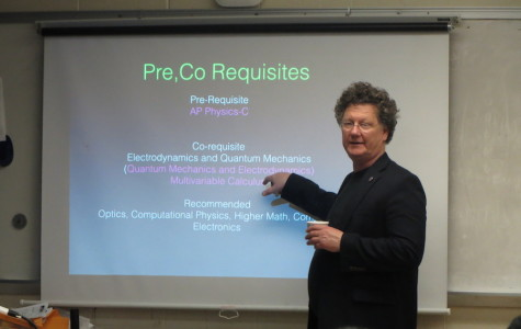 Optics and Modern Physics Lab Director John Dell gives a presentation for juniors on Dec. 4. Photo by Ellen Kan.