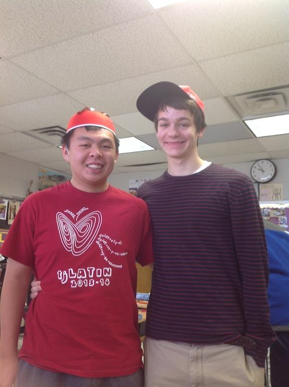 Juniors George Ho and Jack Morris show off the gifts they received for Saturnalia.