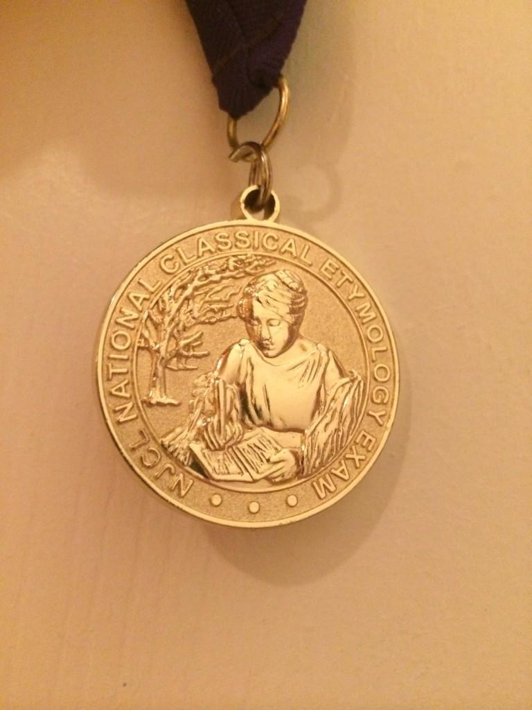 The NCEE gold medal, designed by Class of 2013 Jefferson graduate Hillary Liu.