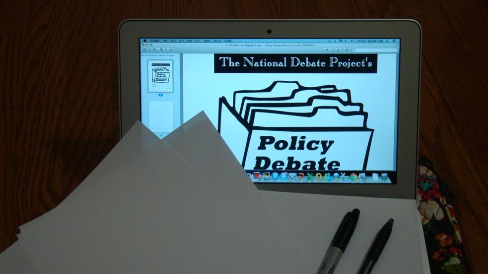 During a Policy debate round, most students use their laptops, papers, and pens to keep track of their opponent's arguments and offer evidence that opposes them.