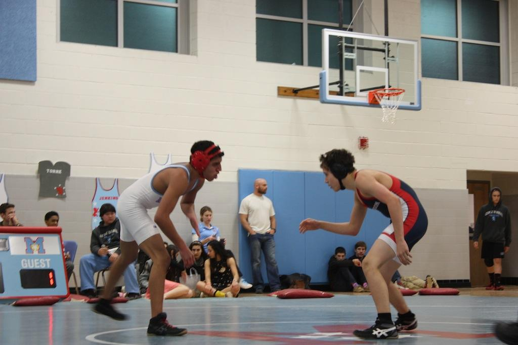 Freshman+Andrew+Yoder+wrestles+for+the+Jefferson+team+in+the+last+meet+of+the+season+at+Marshall+High+School.