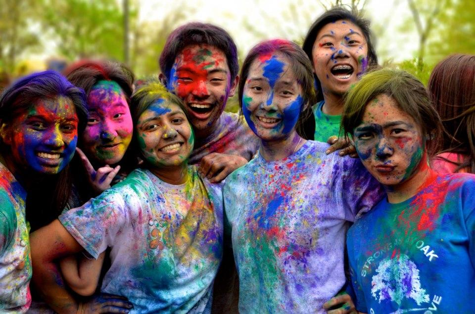Students huddle together after Holi celebrations outside of Jefferson.  Photographer: sophomore Andy Zhao.  photo courtesy of