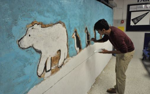 Sophomore class president Kunal Naik spruces up new sophomore lounge with paintings. Photo courtesy of Andy Zhao