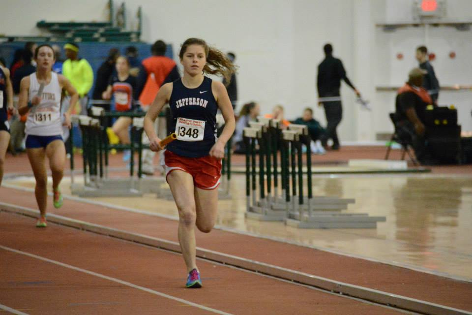 Junior Katrina Junta races as the second leg of the girls' 4x800 relay team. The relay placed fourth and barely missed qualifying for States.