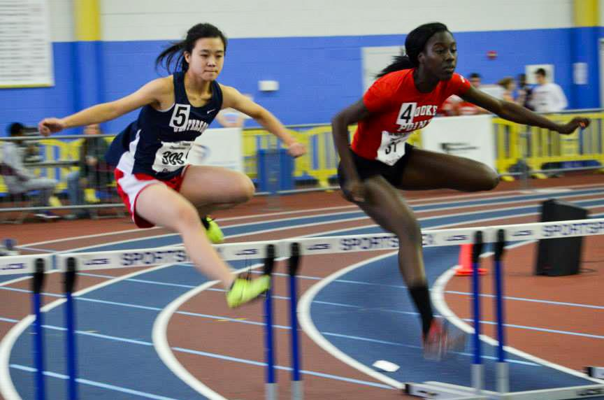 Sophomore Claire Dong (left) placed sixth in the 55-meter hurdles, qualifying for the state championships.
