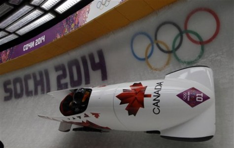 The team from Canada CAN-1, piloted by Kaillie Humphries with brakeman Heather Moyse, speed down the track in their final run during the women's bobsled competition at the 2014 Winter Olympics, Wednesday, Feb. 19, 2014, in Krasnaya Polyana, Russia. The team won the gold medal. (AP Photo/Dita Alangkara)