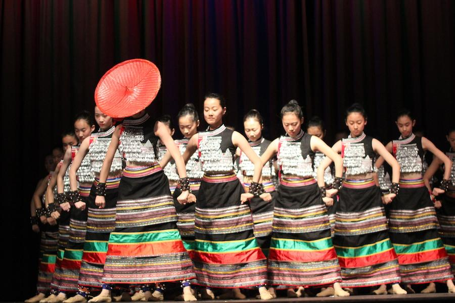 Students of the art troupe of the high school affiliated to the Renmin University of China (RDFZ) performed a traditional dance of a matriarchal village in the Yunnan province.