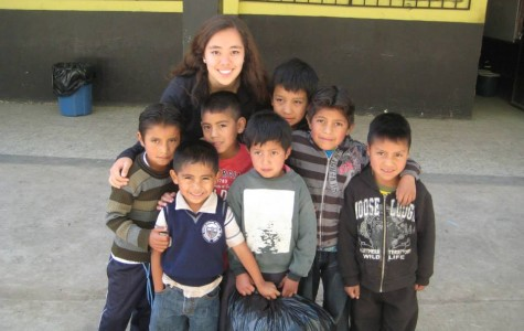 Junior Sage Teasley stands with Guatemalan children from her trip to Guatemala with the Global Public Service Academies (GPSA) for Health during the summer of 2013. Photo courtesy of GPSA.