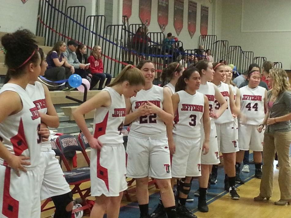 The varsity players in the Jefferson girls' basketball team prepares for the game against Stuart High School after the senior night.