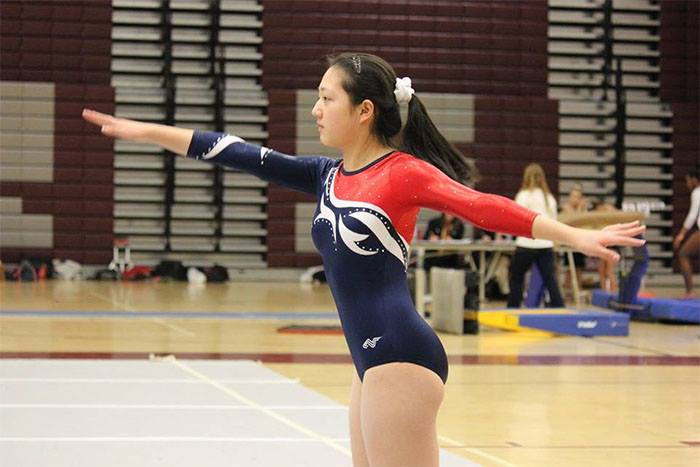 Junior+Jenny+Fang+completes+her+floor+routine+at+the+Capitol+Conference+Championship.