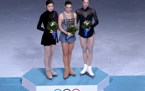 Kim Yu-na, Adelina Sotnikova and Carolina Kostner stand on the podium after the women's figure skating event.  Photo courtesy of Olympics.org.