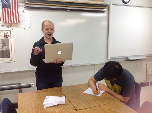 Seniors Yana Kaplun and Richard Wang practice their debate speeches and note taking skills.