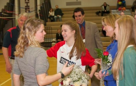 Photo courtesy of www.colonialathletics.org. Senior Mary Forburger celebrates the season's senior night.