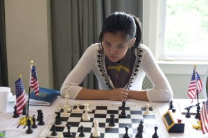 Sophomore Joie Wang playing chess. Photo courtesy of Dora Leticia.