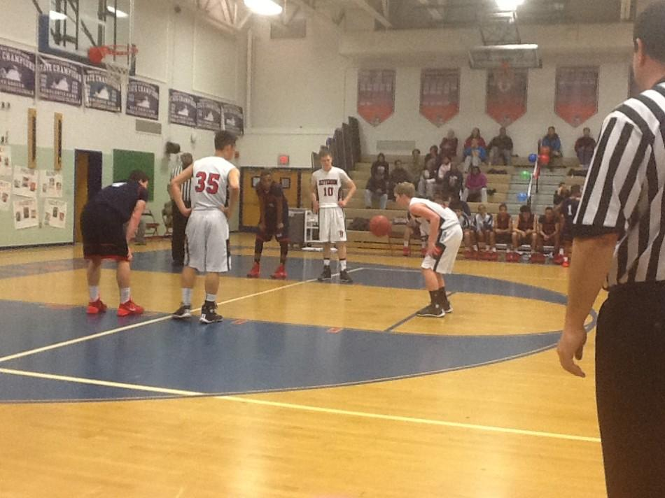 Photo by Lindsay Williams. Boys' basketball team competes against Stuart High School after celebrating senior night.
