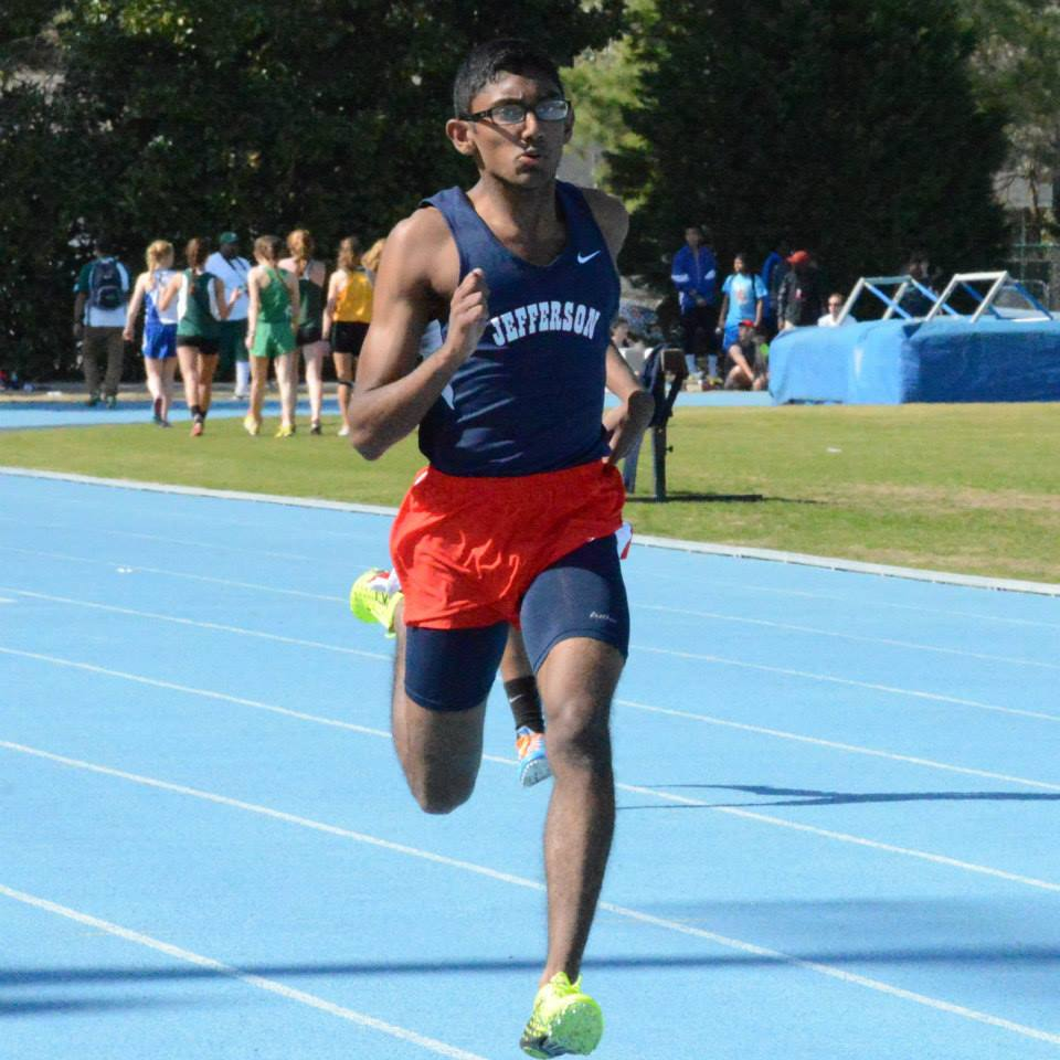 Senior Muthu Chidambaram races to a third place finish in the 200-meter dash. He also won the triple jump.