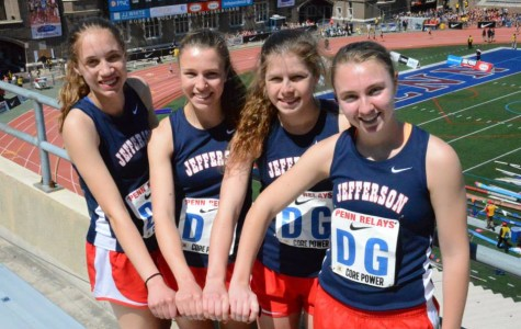 Left to right: juniors Charlene Franke, Emily Moschella, Katrina Junta and Haley Stumvoll ran a new best time for the girls' 4x400-meter relay.