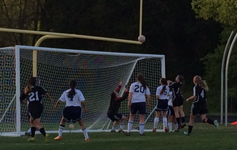 Junior varsity goalie, freshman Raquel Sequeria, saves a shot from the Chantilly striker.
