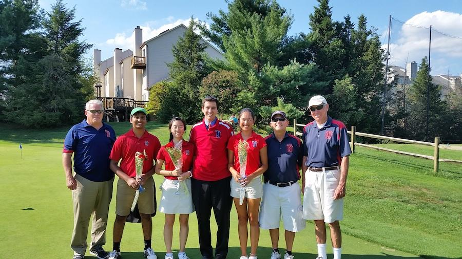 Seniors Rohan Saini, Sandy Cho and Julie Luo stand with  Director of Student Activities and Athletics Rusty Hodges, Principal Evan Glazer and Coaches John Myers and Rick Whittenberger on Sept. 4.