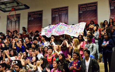 The sophomores show their spirit by raising a banner during roll call.