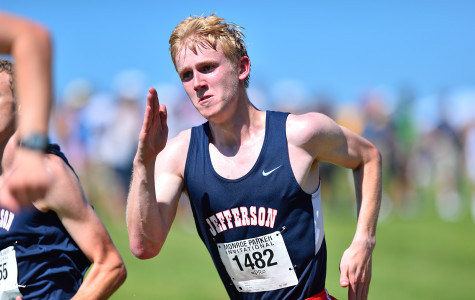 Senior Mitch Woodhouse sprints to the finish at the end of the varsity boys' race.