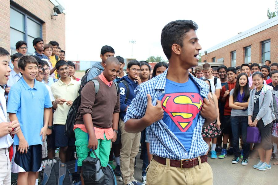 Sophomore Sishaar Rao displays his Superman shirt beneath a plaid button-down for his asking.