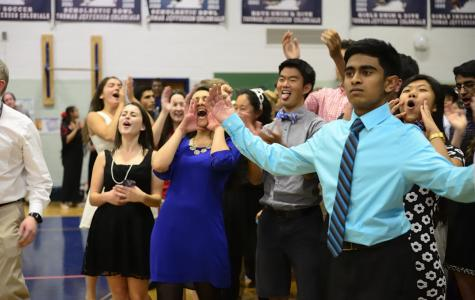 Left to right: Seniors Anna Tursi, Aleesha Toteja, Justin Sun and Nihar Gudiseva cheer.