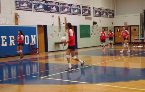 Members of Jefferson's freshmen volleyball team practice before playing against Fairfax High School on Sept. 23.