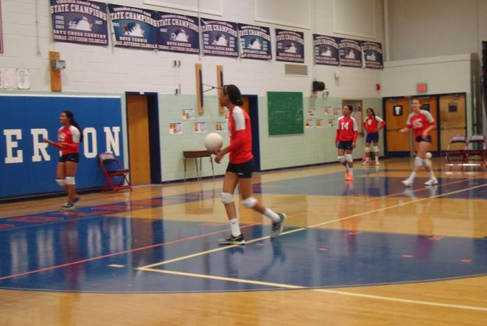 Members+of+Jefferson%27s+freshmen+volleyball+team+practice+before+playing+against+Fairfax+High+School+on+Sept.+23.