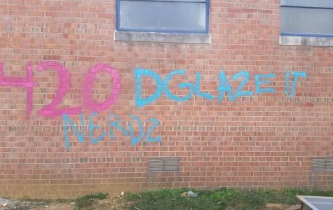 Graffiti graced the brick wall outside the main entrance on Oct. 20.