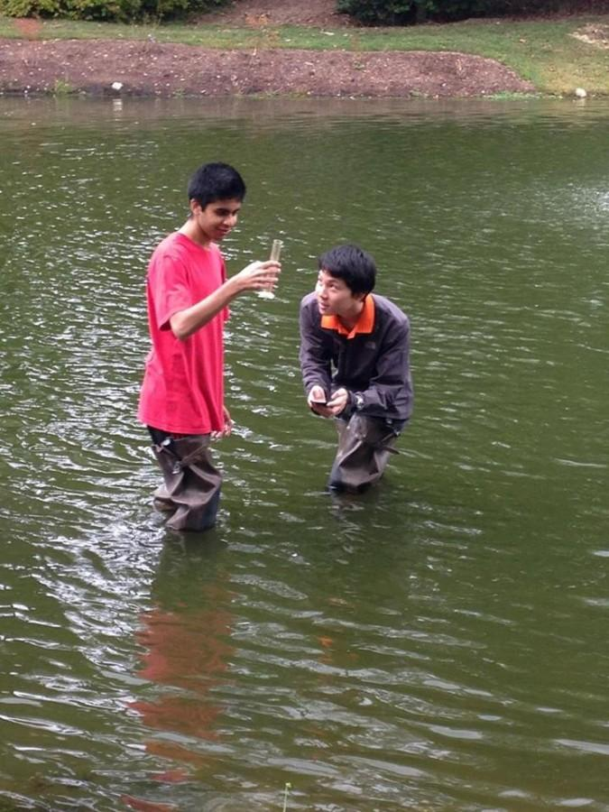 Students at Green Springs test water turbidity in a pond for their IBET research project.
