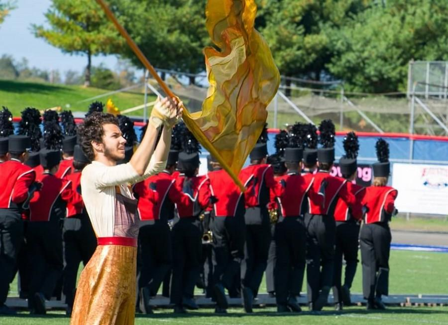 Senior Edi Danalache performs with color guard in Saturday's competition.