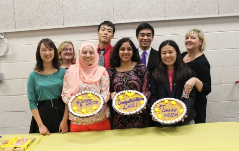 Latin teachers Patricia Lister and Christine Conklin stand with several of the senior Latin Honor Society (LHS) board members, Bobbie Sheng, Reem Mohammad, Orchi Banerjee, Rachel Chon, Peter Kim and Nolan Kataoka, with the cakes at the LHS induction ceremony on Oct. 22.
