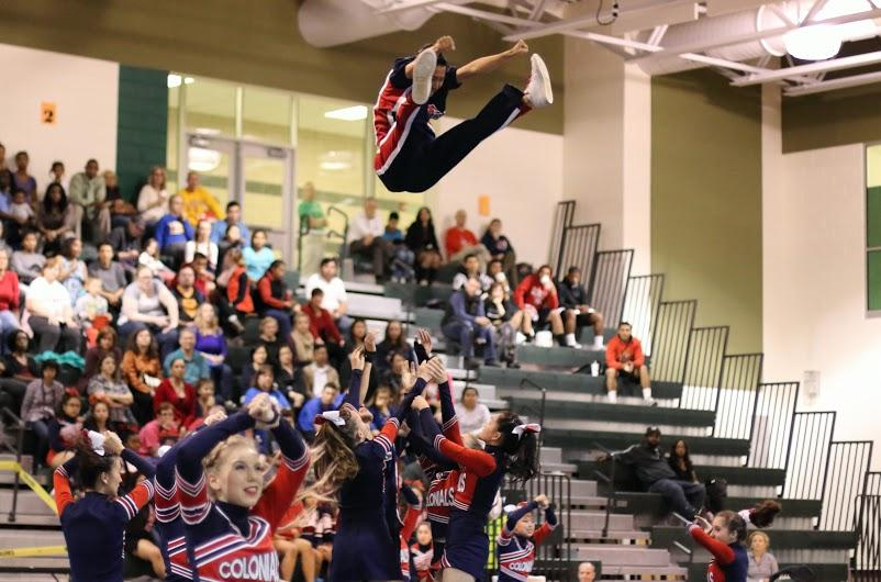 The Jefferson cheerleading team opened the routine at District Finals with the  basket toss of senior Daniel Suh.