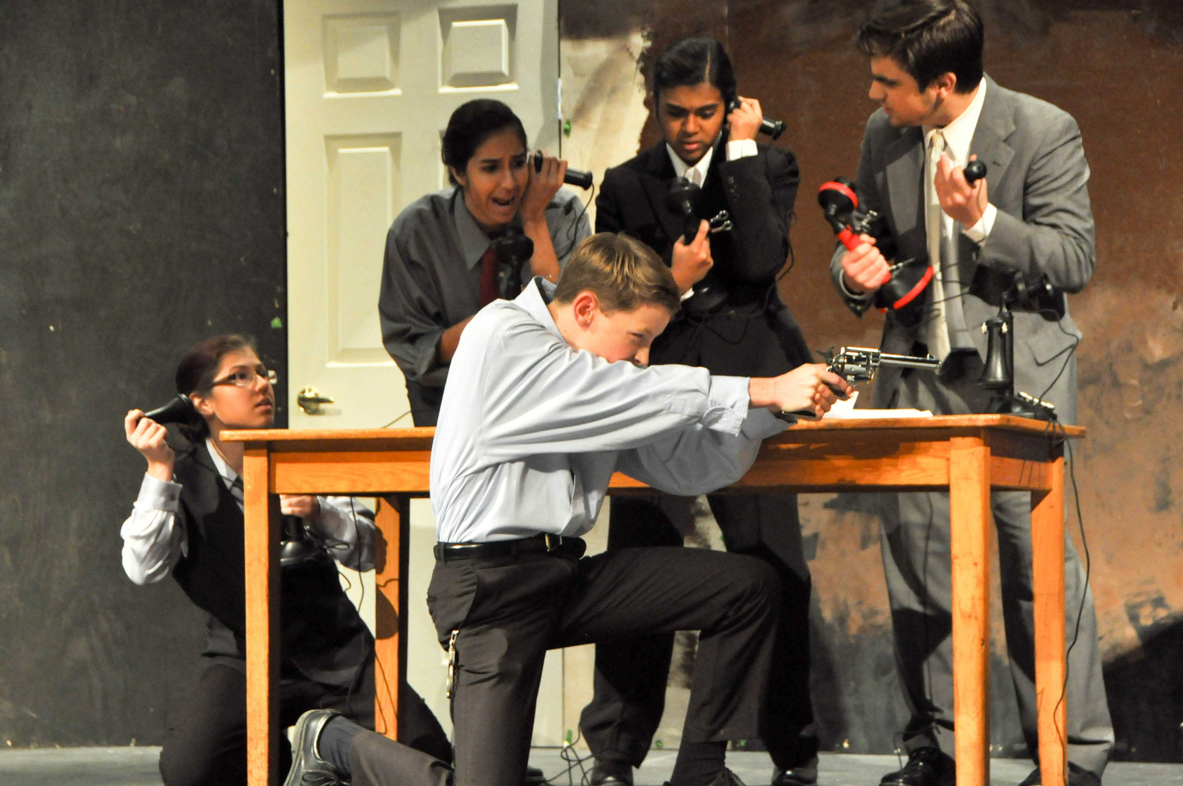 Left to right: Sophomores Elise Holford, Natasha Shukla and CJ Wilson, junior Debi Das and senior Misha Ryjik practice one of the play's most thrilling scenes at the Nov. 13 dress rehearsal.