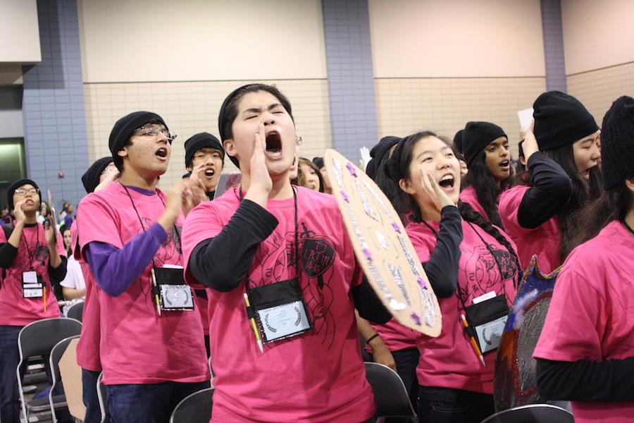 Holding a cardboard shield, junior Junyoung Hwang shout along with his peers during the Spirit Contest.
