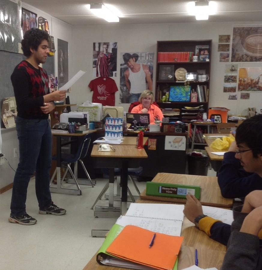 Senior Anant Das reads his poem to the class during Saturnalia celebrations.