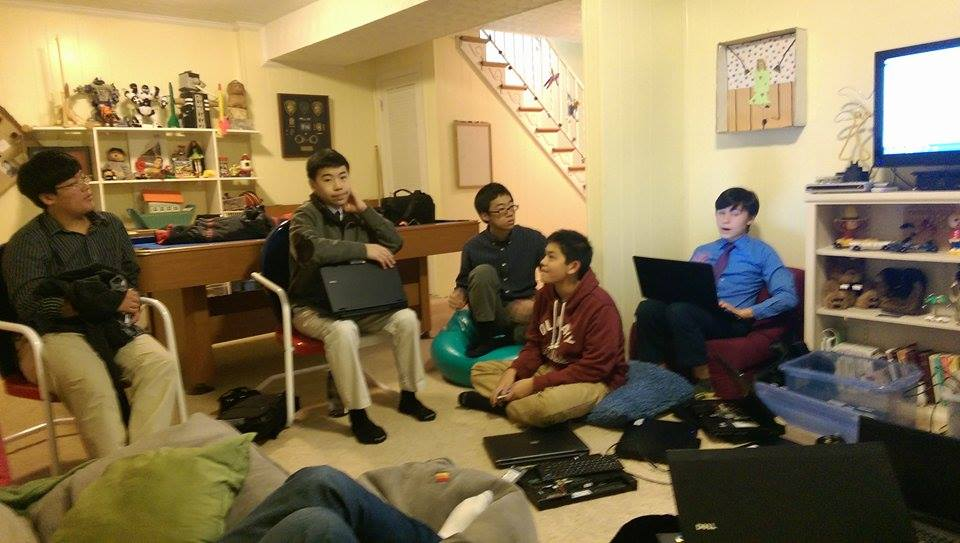 Members of Reboot for Youth gather for a meeting to discuss their latest project of refurbishing computers.