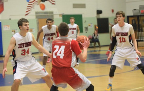 Seniors Seth Jaffe and Ryan Morris try to block a player from the McLean Highlanders.