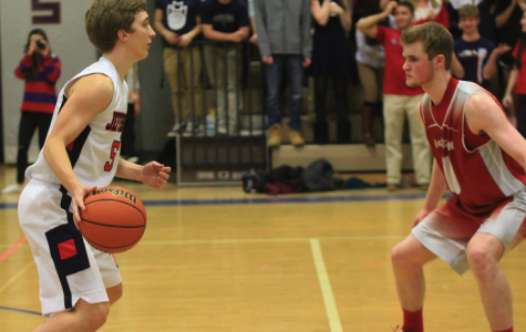 Seniors on the varsity basketball team who participated in the program through their junior year have already experienced the difficulty of balancing both grades and commitment to the team. Senior Addison Dunn faces a Mclean opponent on Jan. 9 victory over the highlanders.