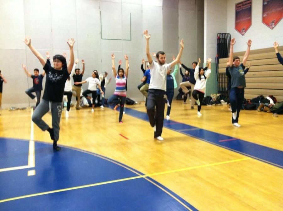 Students+stretch+during+the+yoga+activity+during+eighth+period+held+on+Feb.+11.