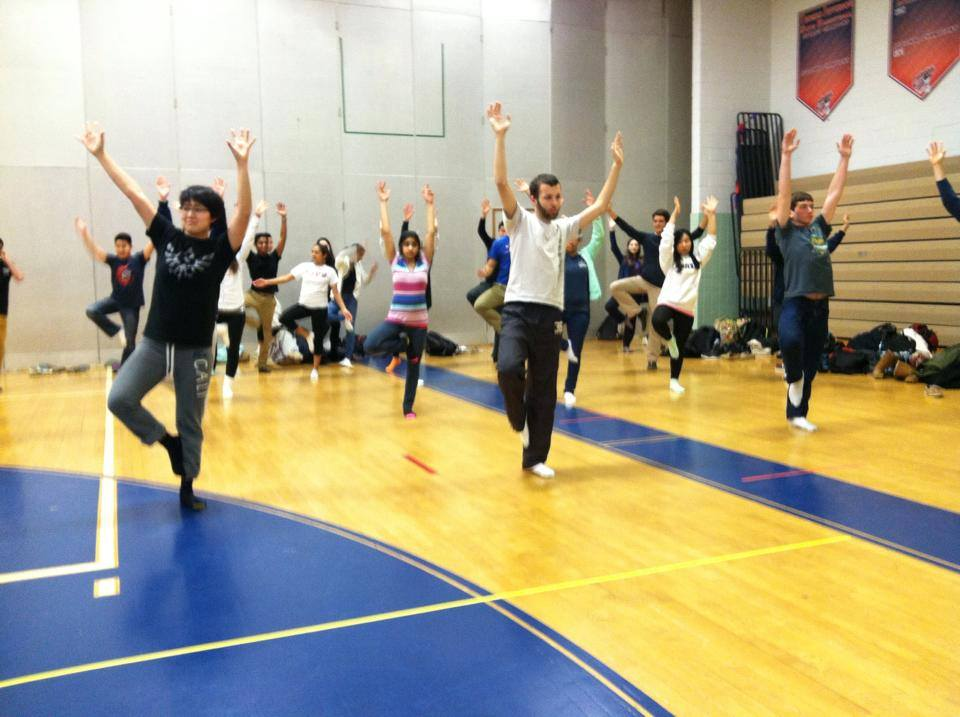 Students stretch during the yoga activity during eighth period held on Feb. 11.
