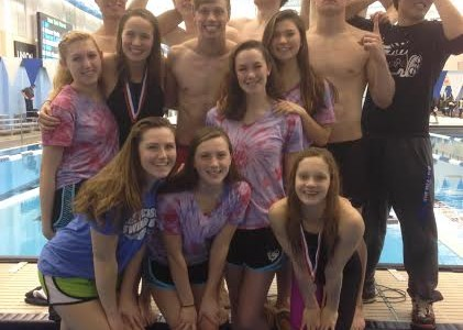 Seniors Gerry Wan, Joseph Doran, Luke Thorsell, Thomas Rogers, Andrew Seliskar, Quintin Frierichs, Peter Kim, Annie Thomas, Sophie Bennett, Taylor Quinn, Anna Weidman, Callan Monette, Jessie Heise and Carrie Heilbrun celebrate the Swim and Dive Team's success at the state championships.