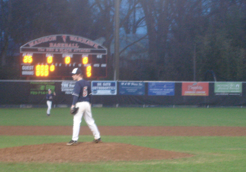 Pitcher Sam Case practices pitching balls during the middle of the fourth inning.