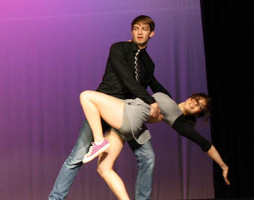 Seniors Adrien Bernard and Monique Mezher perform with Ballroom Dance Club and Swing Dance Club in the talent show.