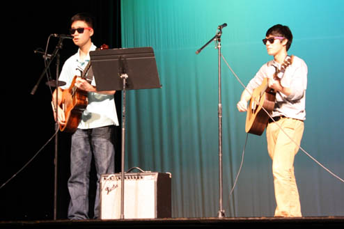 Sophomores+Timmy+Chan+and+Bryan+Lee+sing+and+play+guitar+in+the+talent+show.