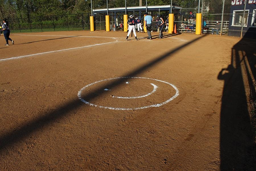 The Jefferson team etched the smiley face into the ground while preparing the field to promote team spirit.