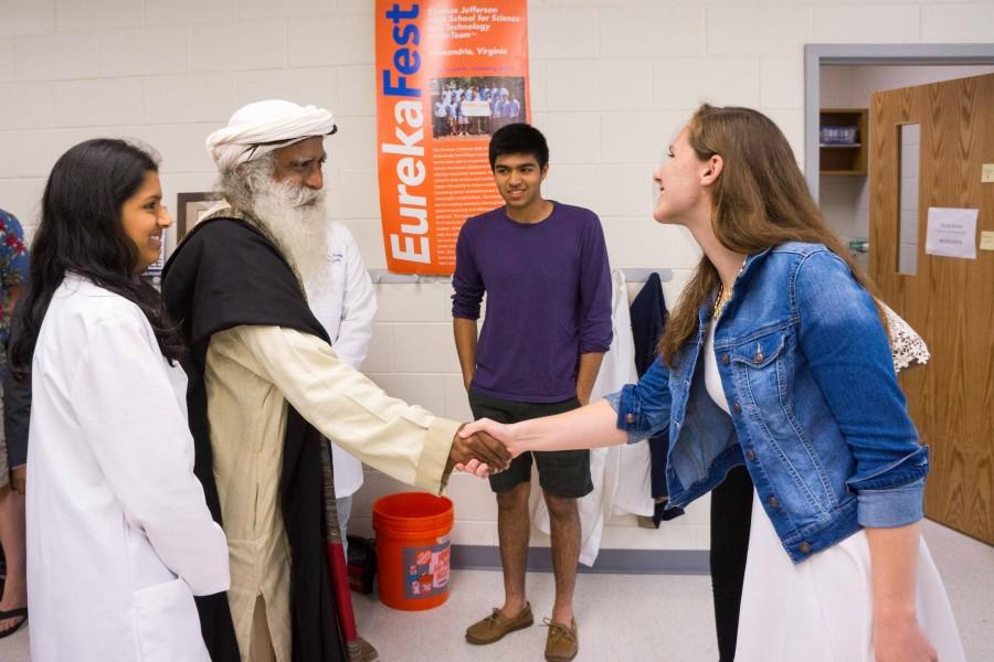 Senior Callan Monette, a member of the Neuroscience Laboratory, shakes hands with Sadhguru before presenting her project.