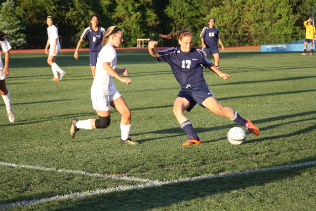 Junior Maaike Blindenbach passes the ball up the field in the Capitol Conference Semifinal game.
